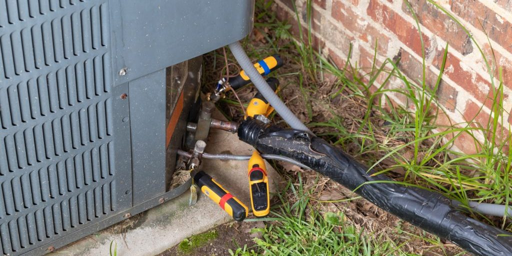 Air Conditioner Repair With Gauges And Tempareature Probes While